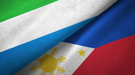 Sierra Leone and Philippines two flags textile cloth, fabric texture Stock Photo