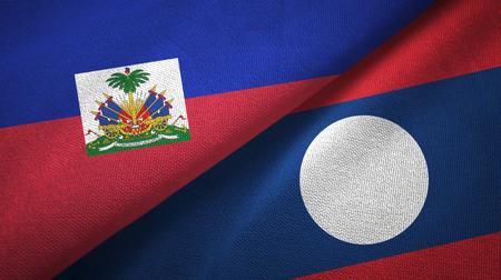 Haiti and Laos two flags textile cloth. Reklamní fotografie