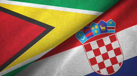 Guyana and Croatia two flags textile cloth, fabric texture Stock Photo