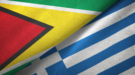 Guyana and Greece flags together textile cloth, fabric texture