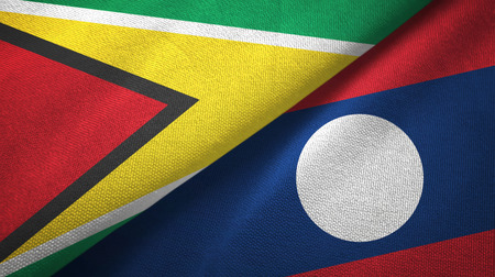 Guyana and Laos two flags textile cloth. Stock Photo