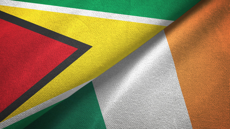 Guyana and Ireland flags together textile cloth, fabric texture