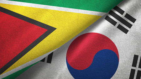 Guyana and South Korea two flags textile cloth, fabric texture Stock Photo