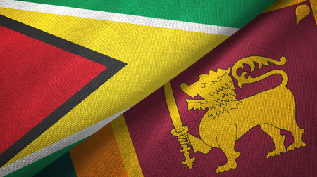Guyana and Sri Lanka two flags textile cloth, fabric texture Stock Photo