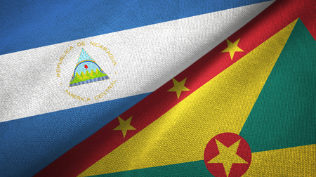 Nicaragua and Grenada two flags textile cloth, fabric texture Stock Photo