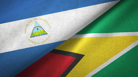 Nicaragua and Guyana two flags textile cloth, fabric texture