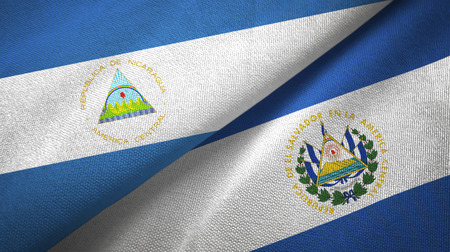 Nicaragua and El Salvador two folded flags together