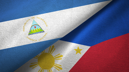 Nicaragua and Philippines two flags textile cloth, fabric texture Stock Photo