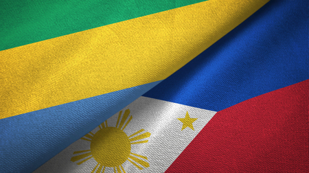 Gabon and Philippines two flags textile cloth, fabric texture Stock Photo