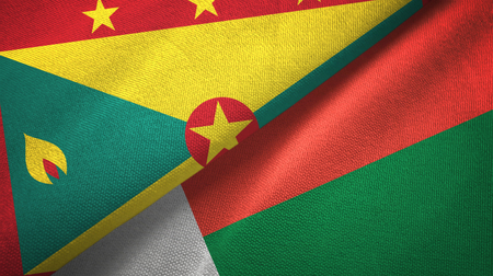 Grenada and Madagascar two flags textile cloth, fabric texture Stock Photo