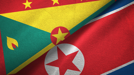 Grenada and North Korea two folded flags together