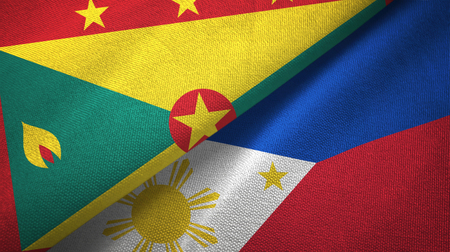 Grenada and Philippines two flags textile cloth, fabric texture Stock Photo