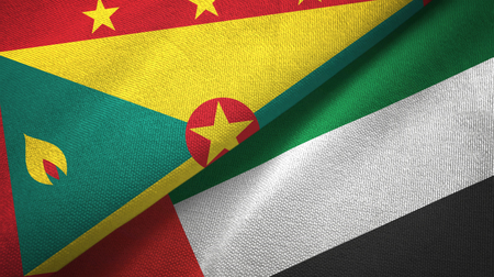 Grenada and United Arab Emirates flags together textile cloth, fabric texture Stock Photo