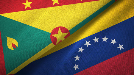 Grenada and Venezuela two flags textile cloth, fabric texture