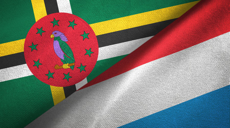 Dominica and Luxembourg two flags textile cloth, fabric texture 版權商用圖片