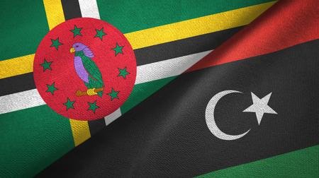 Dominica and Libya two flags textile cloth, fabric texture 版權商用圖片
