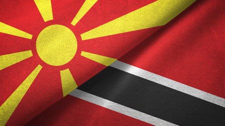 North Macedonia and Trinidad and Tobago two folded flags together Stock Photo
