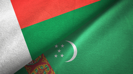 Madagascar and Turkmenistan two flags textile cloth, fabric texture