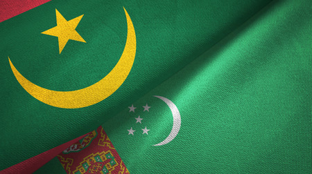 Mauritania and Turkmenistan two flags textile cloth, fabric texture Imagens