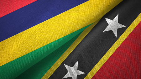 Mauritius and Saint Kitts and Nevis two folded flags together