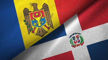 Moldova and Dominican Republic two folded flags together Stock Photo