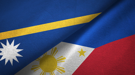 Nauru and Philippines two folded flags together