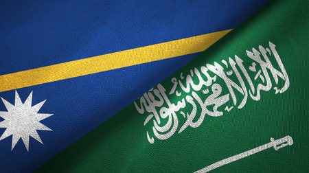 Nauru and Saudi Arabia flags textile cloth, fabric texture. Text on saudi arabian flag means - There is no god but God, Muhammad is the Messenger of God