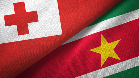 Tonga and Suriname two folded flags together