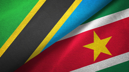 Tanzania and Suriname two flags textile cloth, fabric texture