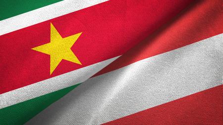 Suriname and Austria two flags textile cloth, fabric texture Stockfoto