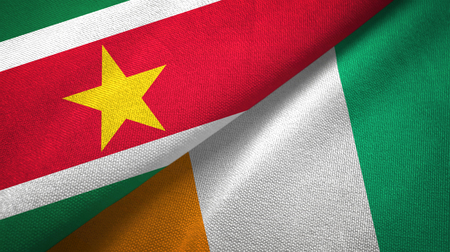 Suriname and Cote dIvoire Ivory coast two flags textile fabric texture Stockfoto