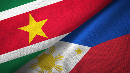 Suriname and Philippines two flags textile cloth, fabric texture Stock Photo