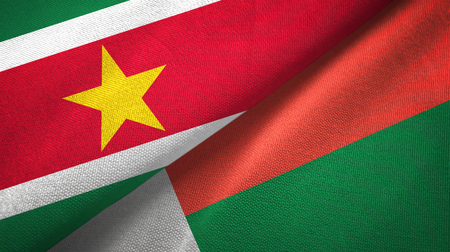Suriname and Madagascar two flags textile cloth, fabric texture