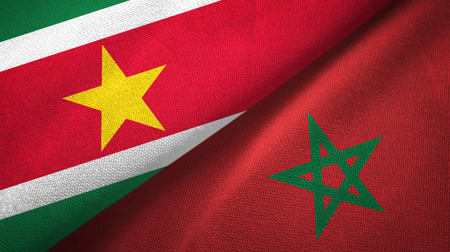 Suriname and Morocco two flags textile cloth, fabric texture Stockfoto