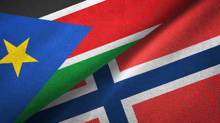 South Sudan and Norway two flags textile cloth, fabric texture Stock Photo