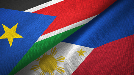 South Sudan and Philippines two flags textile cloth, fabric texture Stock Photo