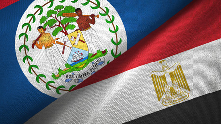 Belize and Egypt flags together textile cloth, fabric texture. Text on egyptian flag means - Arab Republic of Egypt