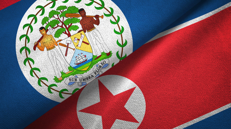 Belize and North Korea two folded flags together Stock Photo