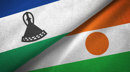 Lesotho and Niger two flags textile cloth, fabric texture Stock Photo - 124873334