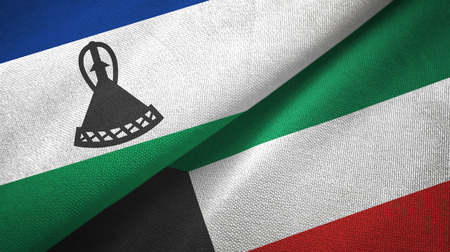Lesotho and Kuwait two flags textile cloth, fabric texture Stock Photo