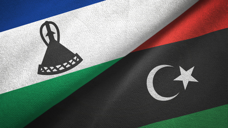 Lesotho and Libya flags together textile cloth, fabric texture