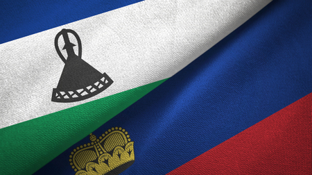 Lesotho and Liechtenstein flags together textile cloth, fabric texture