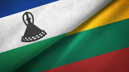 Lesotho and Lithuania flags together textile cloth, fabric texture Stock Photo