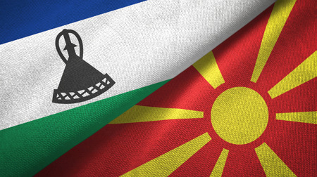Lesotho and North Macedonia flags together textile cloth, fabric texture