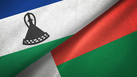 Lesotho and Madagascar two folded flags together