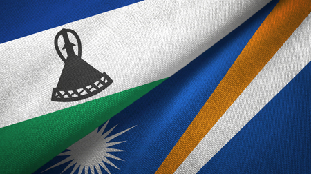 Lesotho and Marshall Islands two folded flags together Stock Photo
