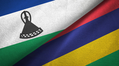Lesotho and Mauritius two folded flags together