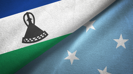Lesotho and Micronesia two folded flags together Stock Photo