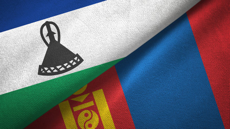 Lesotho and Mongolia two folded flags together Stock Photo