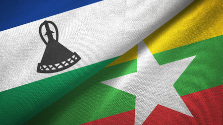 Lesotho and Myanmar two flags textile cloth, fabric texture